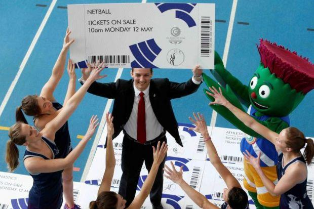 David Grevemberg chief executive of Glasgow 2014 with Games mascot Clyde and members of the Scottish Thistles netball team helps launch ticket sales at Scotstoun in MayPhotograph: Martin Shields