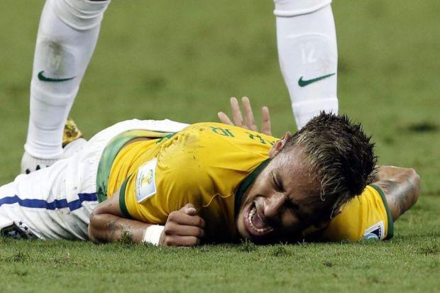 Neymar lies on the pitch after his collision with Juan Camilo Zuniga   Photograph: EPA