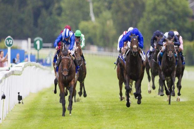 Mukhadram, front left, carries Paul Hanagan to a comfortable two-length victory in the Coral-Eclipse Photgraph: PA