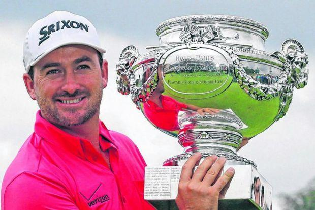 Graeme McDowell  poses with  the French Open trophy after taking advantage of Kevin Stadler's collapse.Picture: PA