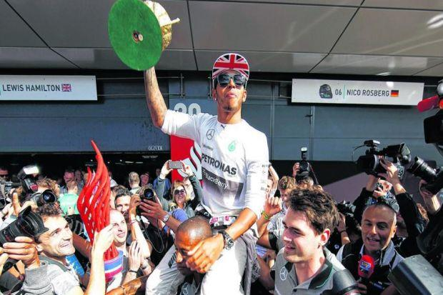 Lewis Hamilton is carried through the paddock following his victory in the British Grand Prix, with team-mate and championship leader Nico Rosberg unable to finish. Picture: Getty