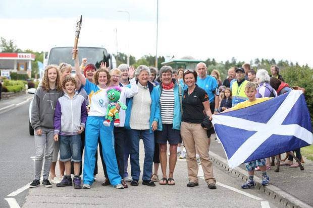Callander residents pose with the baton and the saltire. Picture by Chris Radburn.