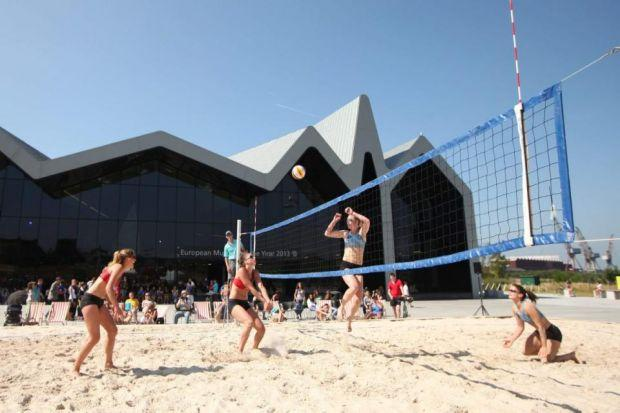 LIFE'S A BEACH: The Riverside Museum is transformed for the Masters Beach Volleyball competition on Saturday.