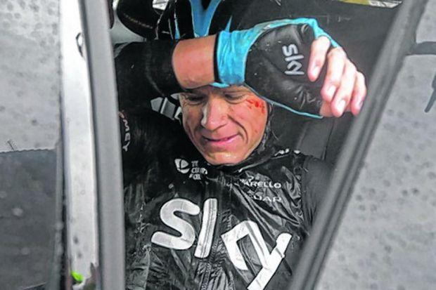 Chris Froome in the team car, having abandoned the race after a second fall yesterday and third in two days. Picture:  Laurent Cipriani/AP