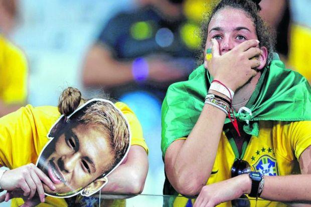 Brazil fans in Belo Horizonte are left in disbelief following the humiliation of their side by Germany. Picture: Reuters
