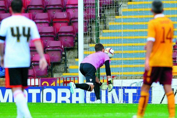 Keeper Dan Twardzik is left scrambling in vain after his error saw Motherwell fall two behind Photograph: SNS