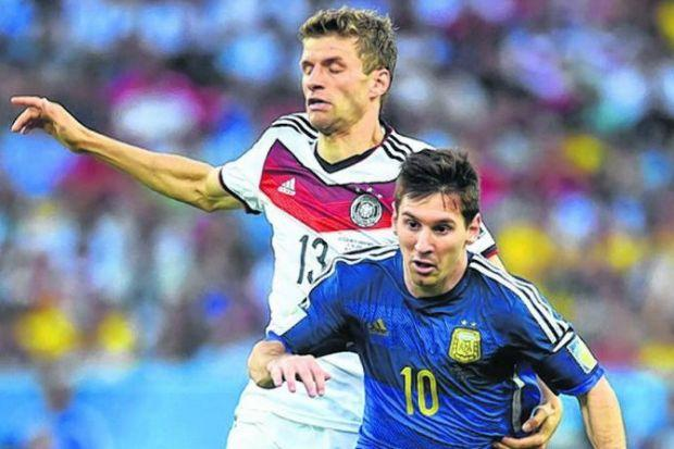 Thomas Mueller and Lionel Messi lock horns at the Maracana. Picture: Getty