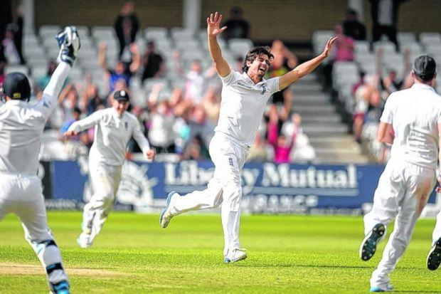 England captain Alastair Cook celebrates after dismissing India's Ishant Sharma. Picture: Reuters