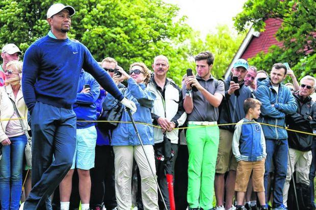 Tiger Woods was the centre of attention as he prepared at Hoylake on Sunday.  Picture: Matthew Lewis/Getty Sport
