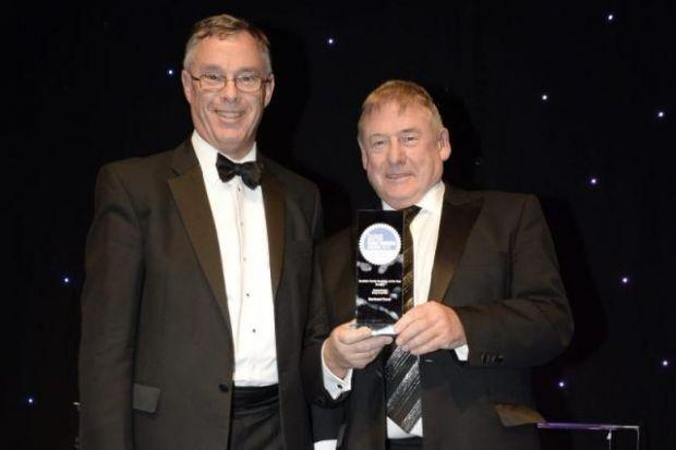 FLASHBACK:  Bill Munro of Barrhead Travel, last year's winners of the large family business of the year award, receives his award from Tom Craig of Craig Corporate. Picture: Jamie Simpson