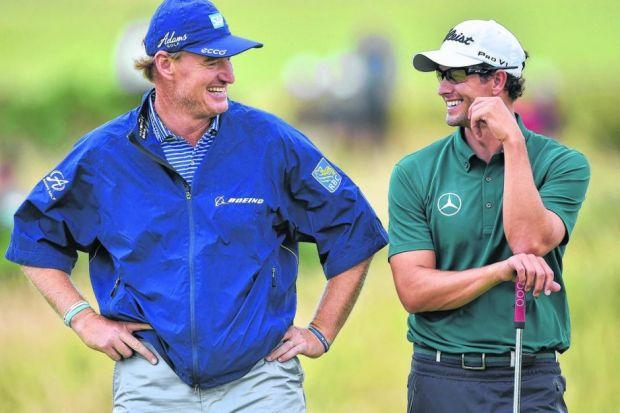 Ernie Els and Adam Scott, two of the perennial contenders at the Open, share a laugh at practice yesterday. Picture: Getty Sport
