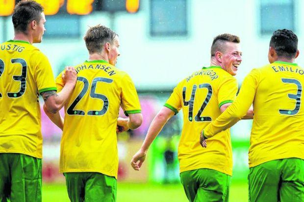 Callum McGregor, in his first competitive match for Celtic, is congratulated by his team-mates after scoring the winner on Tuesday. Picture: SNS