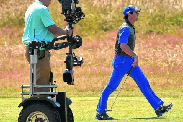 Rory McIlroy strides purposefully down the 14th fairway en route to an opening six-under-par 66 and the lead by one shot from the Italian Matteo Manassero. Picture: Reuters