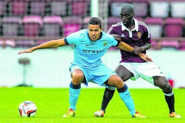 BIG SHOTS: Jack Rodwell of Manchester City holds off Hearts' Morgaro Gomis en route to a 2-1 friendly victory at Tynecastle. Picture: SNS