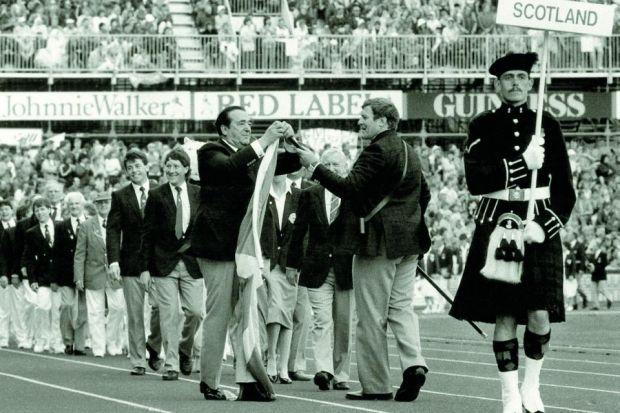 Robert Maxwell rushes to the aid of Scotland's flag-bearer Albert Patrick when the Saltire comes away from the flagstaff