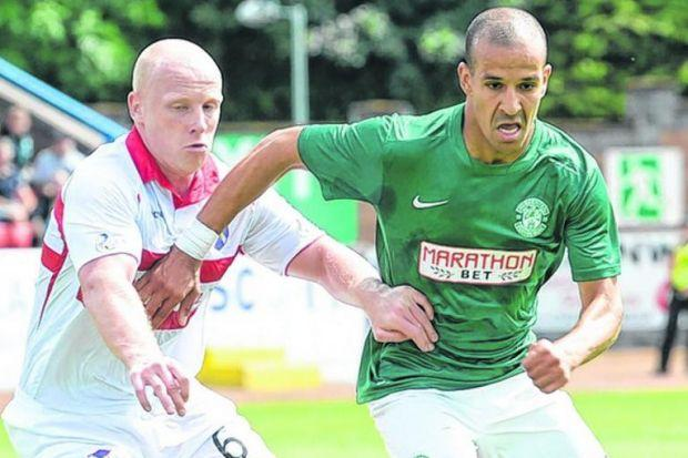 Hibernian's French striker Farid El Alagui, right, who played for just under 60 minutes, gets ahead of Stirling defender Chris Smith. Picture: SNS