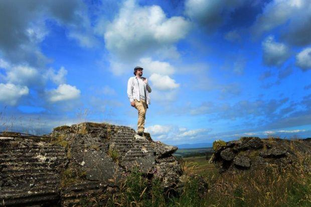 WONDER WALL:  Historian and archaeologist Dr Tony Pollard stands atop the replica of the Nazi's defensive wall at Sherriffmuir, near Dunblane. Picture: Julie Howden