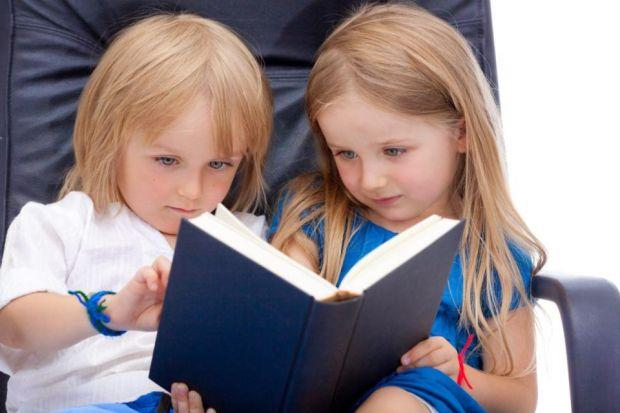 book WORMS: A study of identical twins found a correlation between reading ability at a young age and intelligence at age 16. Picture: Quinn Martin