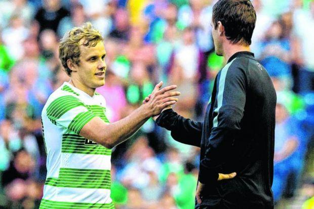 Ronny Deila congratulates Teemu Pukki but he was otherwise sanguine about his side's performance. Picture: SNS