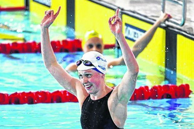 Hannah Miley celebrates after retaining the 400m medley gold medal yesterday. Picture: Nick Ponty