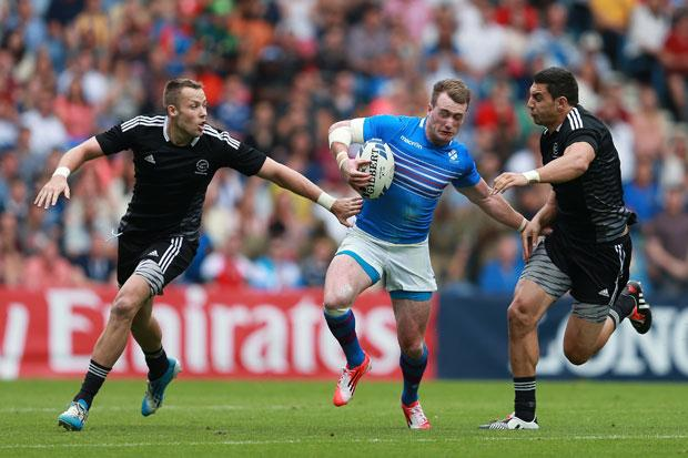 Scotland's Stuart Hogg is tackled by New Zealand's Bryce Heem