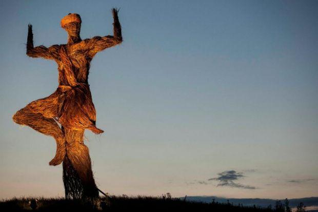 Main photograph: This year's Wicker Man effigy awaits the flames Inset, from left: One of the whacky figures at the festival, organiser Helen Chalmers and Edinburgh's hip-hop outfit Young FathersPhotographs: Brian Sweeney