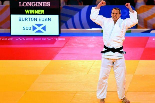 Chris Sherrington's massive smile sums up the elation of winning gold in the +100kg competition Photograph: Nick Ponty
