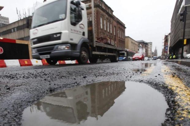 DIPS IN THE ROAD: Potholes lead to a number of problems for businesses across the country. Picture: Colin Mearns