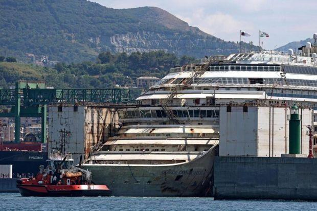 journey's END: The Costa Concordia is moored in Genoa after being lifted off rocks on which it grounded, refloated and towed away for scrapping