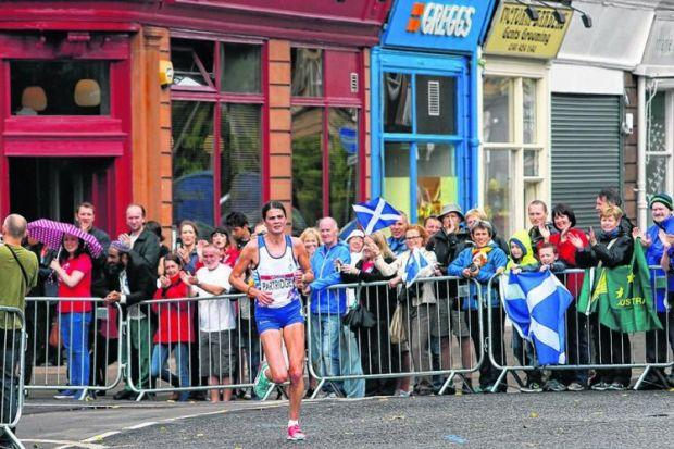 Susan Partridge, who finished sixth, runs past the Greggs queue. Picture: Colin Mearns