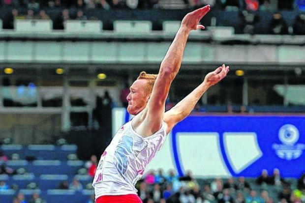 Greg Rutherford, the only star of 'Super Saturday' from the London Olympics at these Games, leaps to the long-jump title. Picture: Colin Mearns