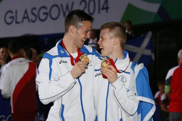 Josh Taylor and Charlie Flynn celebrate after winning gold   Photograph: Colin Mearns