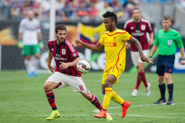 Raheem Sterling #31 of Liverpool controls the ball in front of Riccardo Saponara #8 of A.C. Milan during first half action in the Guinness International Champions Cup at Bank of America Stadium on August 2, 2014 in Charlotte, North Carolina.