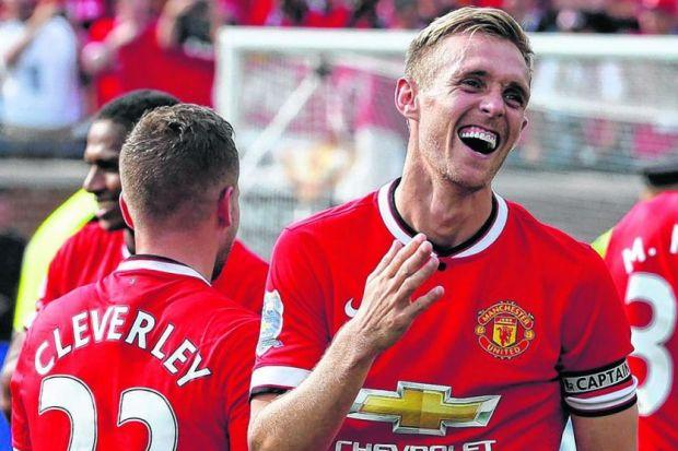 All Smiles: Darren Fletcher led Manchester United to a win over Real Madrid in front of a crowd of 109,318 fans. Picture: EPA