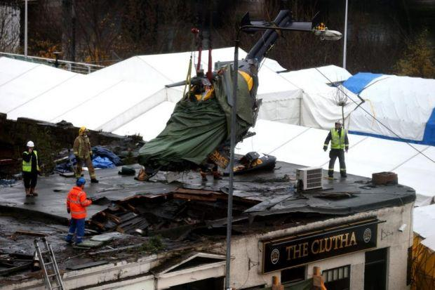 horror SCENE: The helicopter is removed from the Clutha after it crashed there on N
