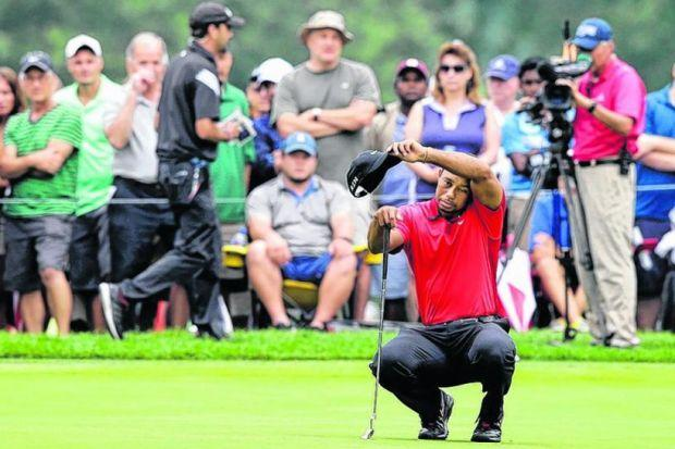 Tiger Woods withdrew from the WGC Bridgstone Invitational last night. Picture: PA