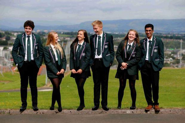 happy DAYS: Talented pupils at St Luke's High School in Barryhead are all smiles after securing some excellent examination results. Picture: Martin Shields