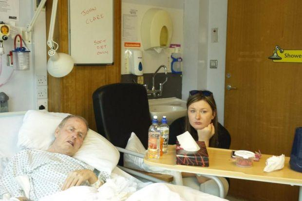 CARE FEARS: John Clark, pictured with grandaughter Zoe, in Monklands Hospital, where concerns were raised about the care h