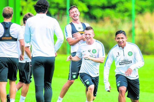 Callum McGregor, Eoghan O'Connell and Emilio Izaguirre train, no doubt cheerier after being informed they were still in the Champions League. Picture: SNS
