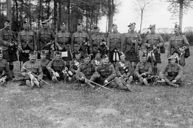 Scottish pipers gather at at a military horse show at a rest area behind the lines at Liencourt, near Arras, in May 1917Photograph:  Imperial War Museum