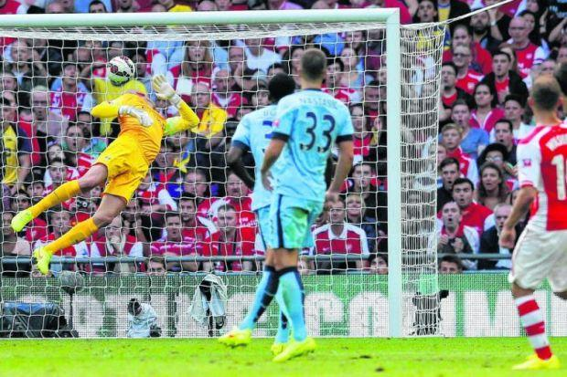 Olivier Giroud, right, watches as his sumptuous shot flies past Willy Caballero and into the net to cap a comprehensive victory for Arsenal as the London side overcame Manchester City at Wembley to secure the FA Community Shield. Picture: Reuters
