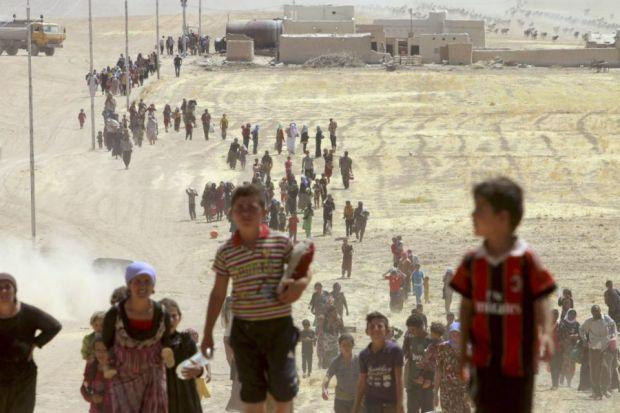 ESCAPE: Displaced people have been fleeing Islamic State forces to head from the Sinjar area towards the Syrian border. Picture: Reuters/Rodi Said