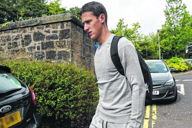 Alexsandar Tonev leaves Ross Hall following his medical yesterday. Picture: SNS