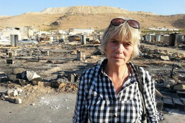 Maggie Tookey: The aid worker in front of the remains of  tents in the camps at Arsal, which were destroyed by fire after shelling.