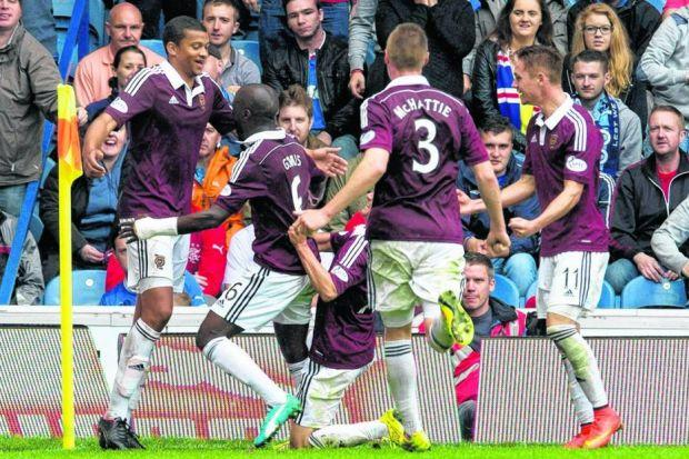 Hearts players surround goalscorer Osman Sow after he scored the winner against Rangers. Picture: SNS