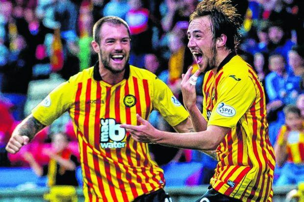 Stuart Bannigan reacts after opening the scoring on an impressive night for his Thistle side. Picture: SNS
