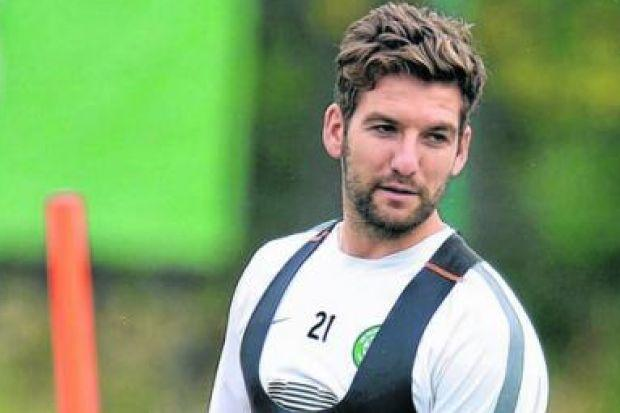 Charlie Mulgrew says he is not embarrassed by Celtic's reinstation to the Champions League. Picture: SNS
