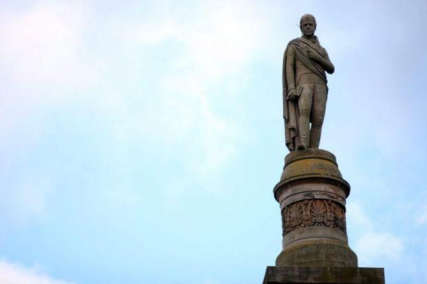 Alan Riach and Sandy Moffat, above, discuss the influence of Sir Walter Scott, who is commemorated in Edinburgh, right
