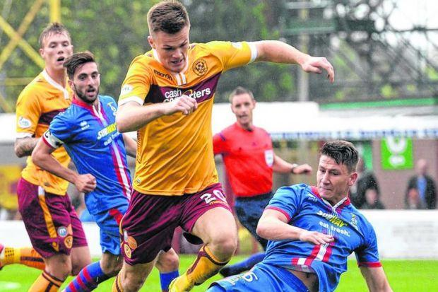 Fraser Kerr skips past Josh Meekings, but Motherwell would rarely trouble their visitors. Picture: SNS