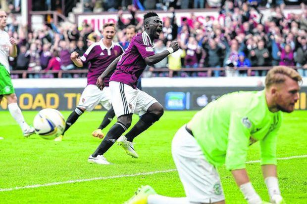 Prince Buaben shows his delight after beating Hibernian goalkeeper Mark Oxley from the penalty spot to put Hearts 2-0 ahead. Picture: SNS